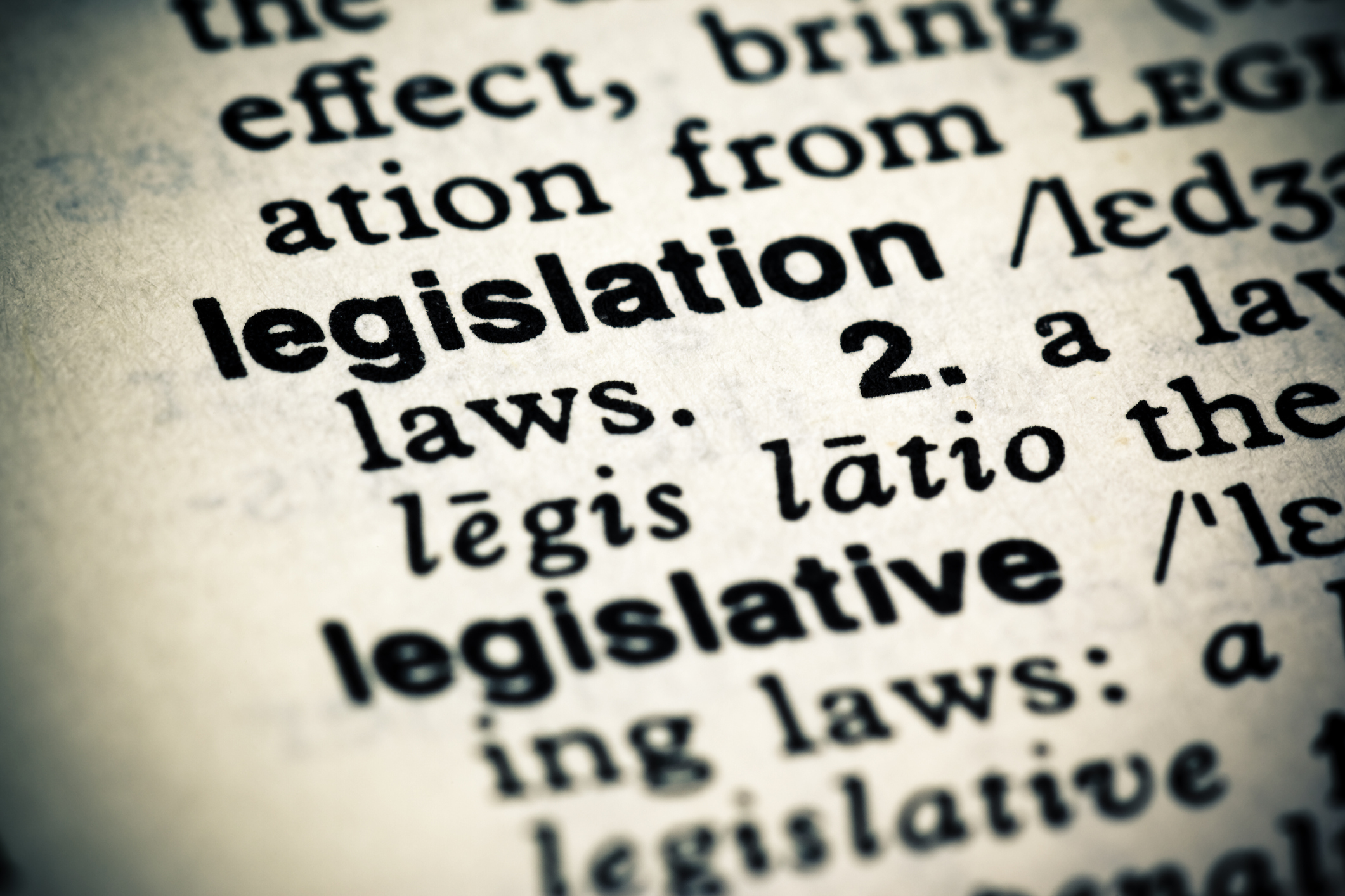 A cross processed image of the dictionary definition of the word: Legislation.