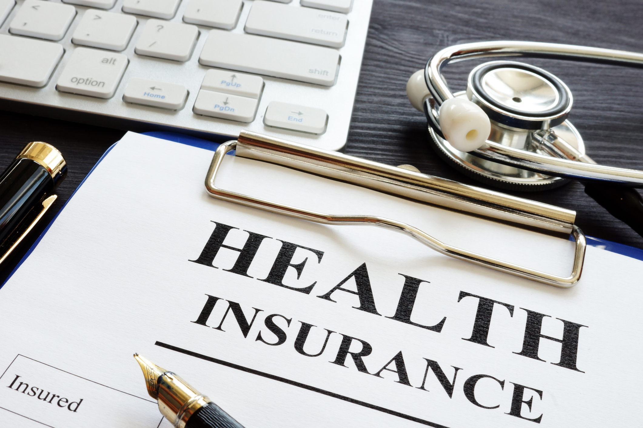 Individual health insurance policy and stethoscope.