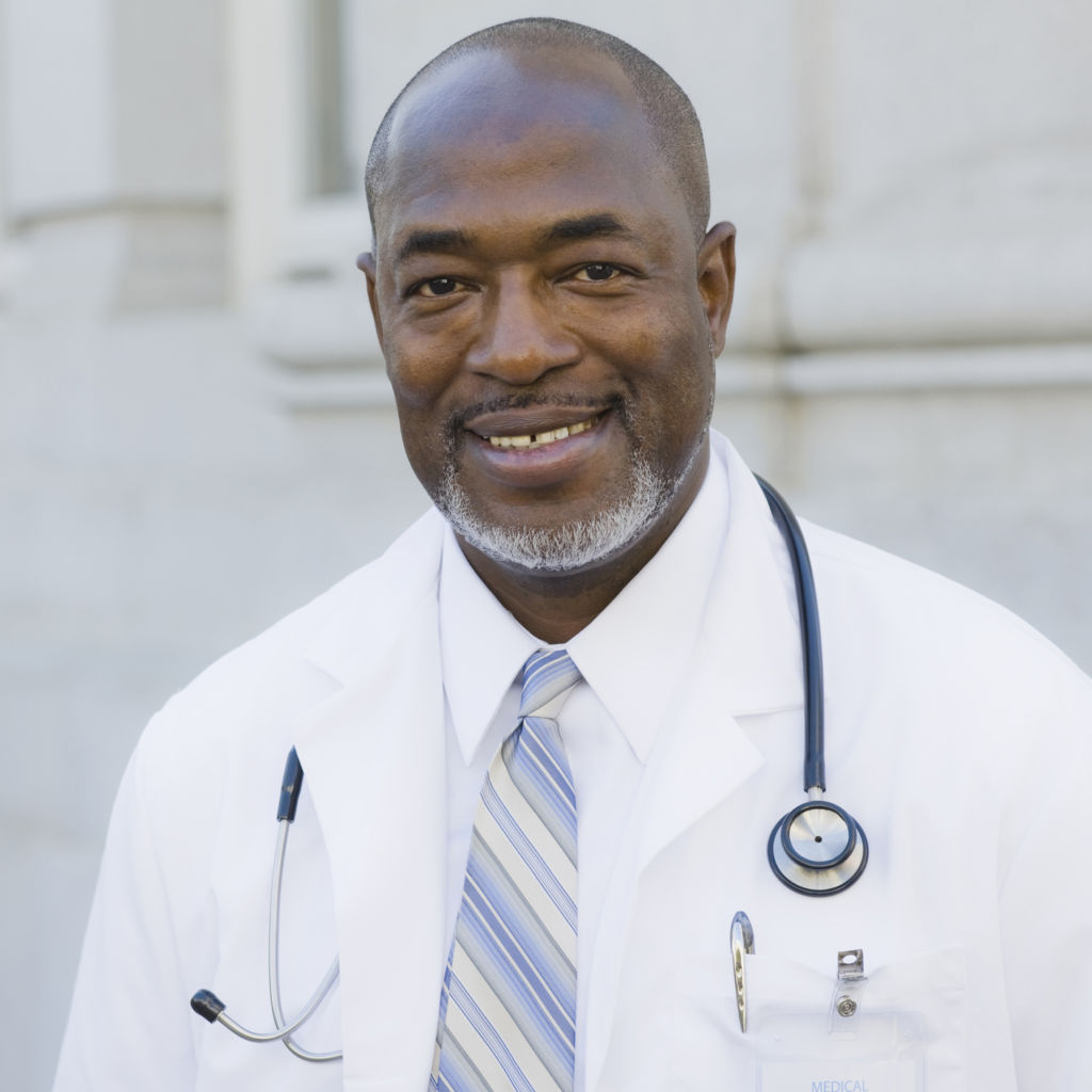 Male Doctor Standing Outside With Stethoscope Around Neck