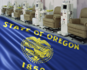 row of dialysis chairs at a clinic with Oregon state flag blended into the picture