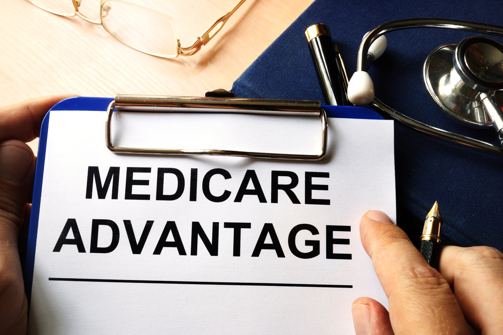 Medicare advantage in a clipboard. Health care insurance concept.